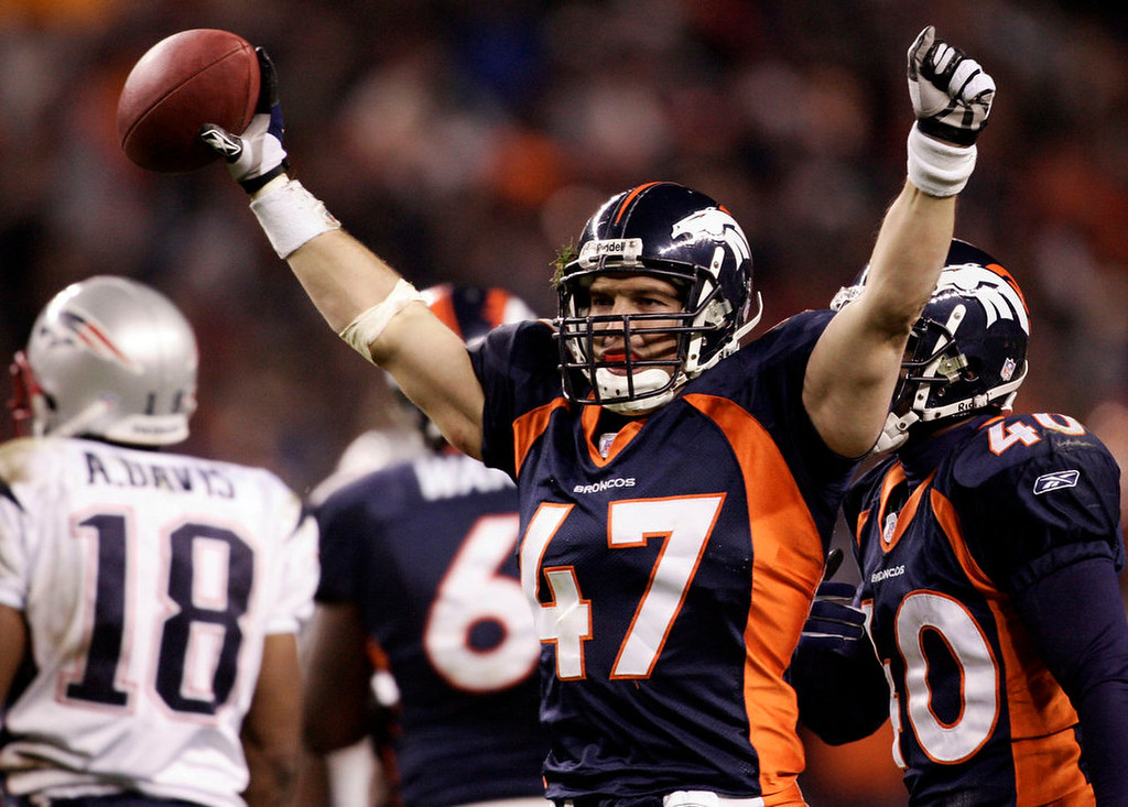 . Denver Broncos safety John Lynch celebrates an interception against the New England Patriots during the fourth quarter of their AFC divisional playoff game at Invesco Field at Mile High , Saturday, Jan. 14, 2006. Denver beat New England, 27-13, to advance to the AFC Championship game. (AP Photo/Jack Dempsey)