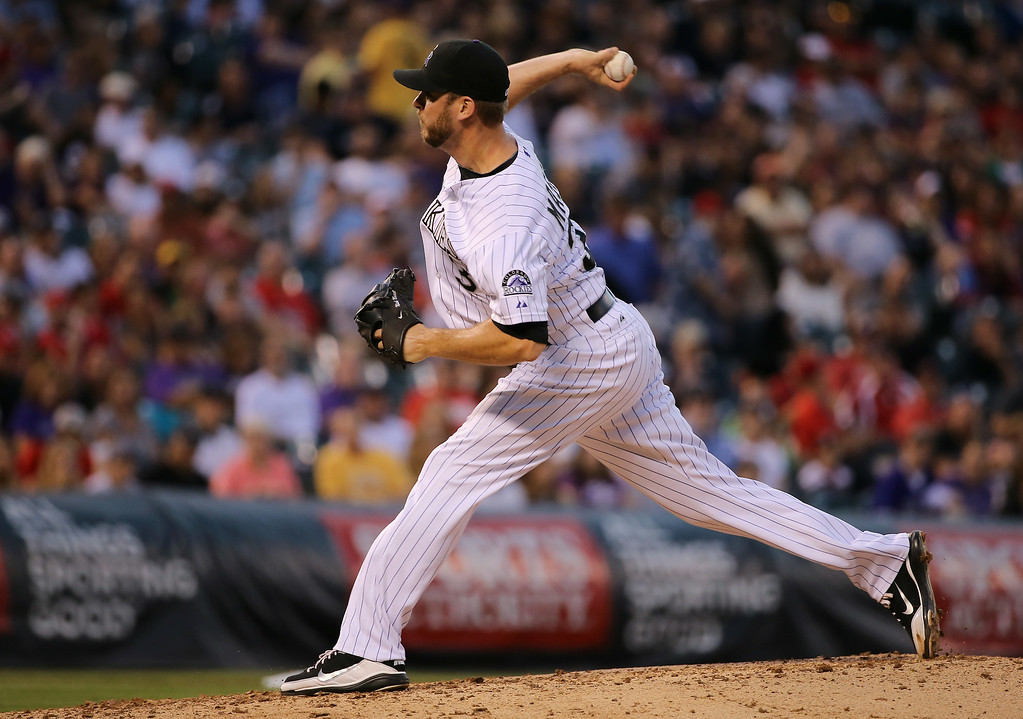 . DENVER, CO - AUGUST 15:  Relief pitcher Nick Masset #37 of the Colorado Rockies delivers against the Cincinnati Reds at Coors Field on August 15, 2014 in Denver, Colorado.  (Photo by Doug Pensinger/Getty Images)