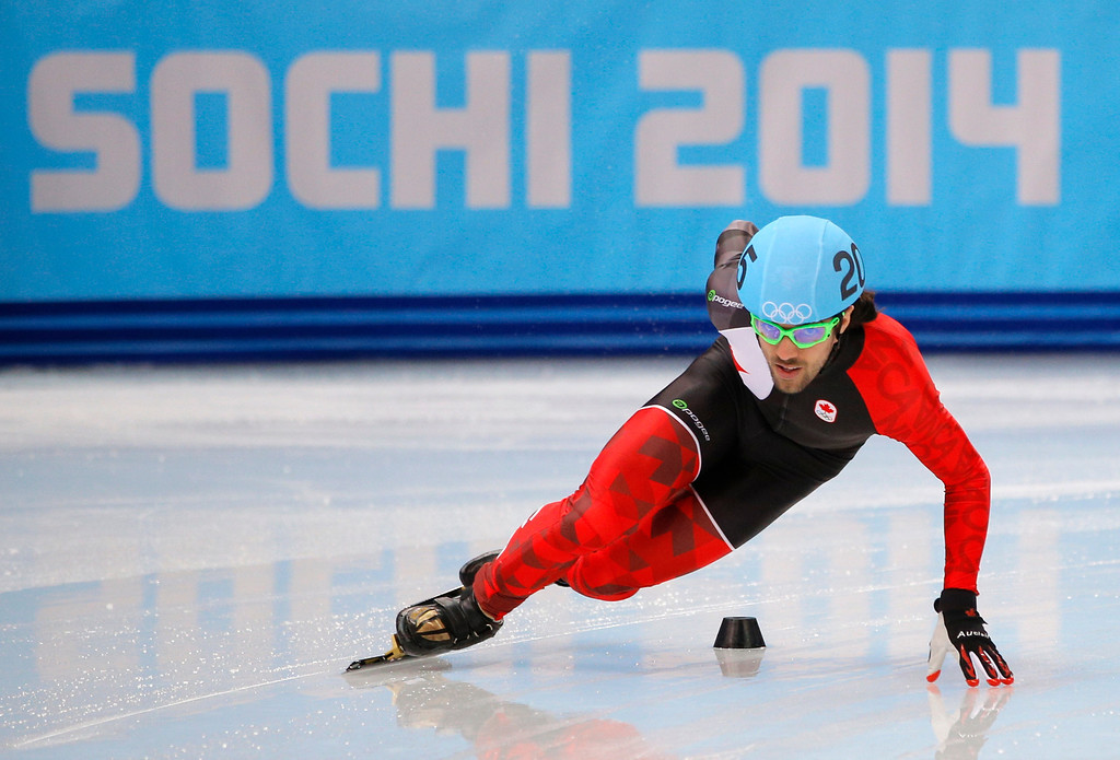. Charles Hamelin of Canada competes in a men\'s 500m short track speedskating heat at the Iceberg Skating Palace during the 2014 Winter Olympics, Tuesday, Feb. 18, 2014, in Sochi, Russia. (AP Photo/Vadim Ghirda)