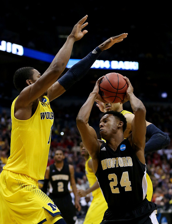. Justin Gordon #24 of the Wofford Terriers goes up against Glenn Robinson III #1 of the Michigan Wolverines in the second half during the second round of the 2014 NCAA Men\'s Basketball Tournament at BMO Harris Bradley Center on March 20, 2014 in Milwaukee, Wisconsin.  (Photo by Jonathan Daniel/Getty Images)