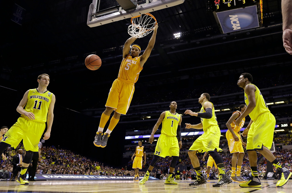 . Tennessee\'s Jarnell Stokes dunks during the second half of an NCAA Midwest Regional semifinal college basketball tournament game against the Michigan Friday, March 28, 2014, in Indianapolis. (AP Photo/David J. Phillip)