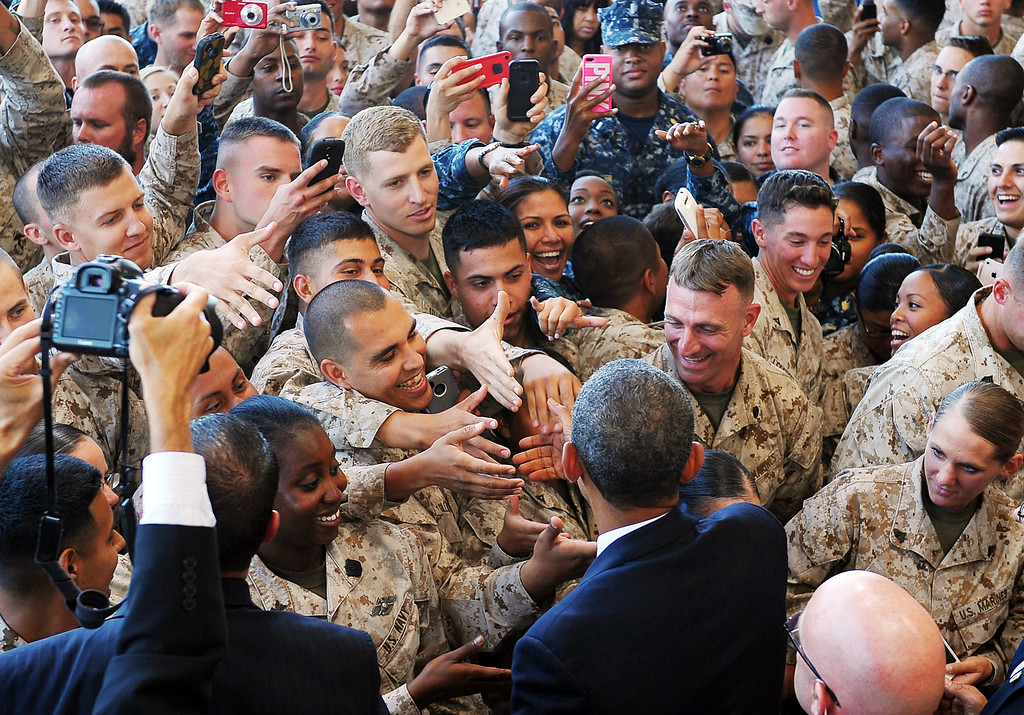 . US President Barack Obama greets Marines after speaking at Camp Pendleton in California on August 7, 2013.. Obama thanked soldiers and their families for their service. MANDEL NGAN/AFP/Getty Images