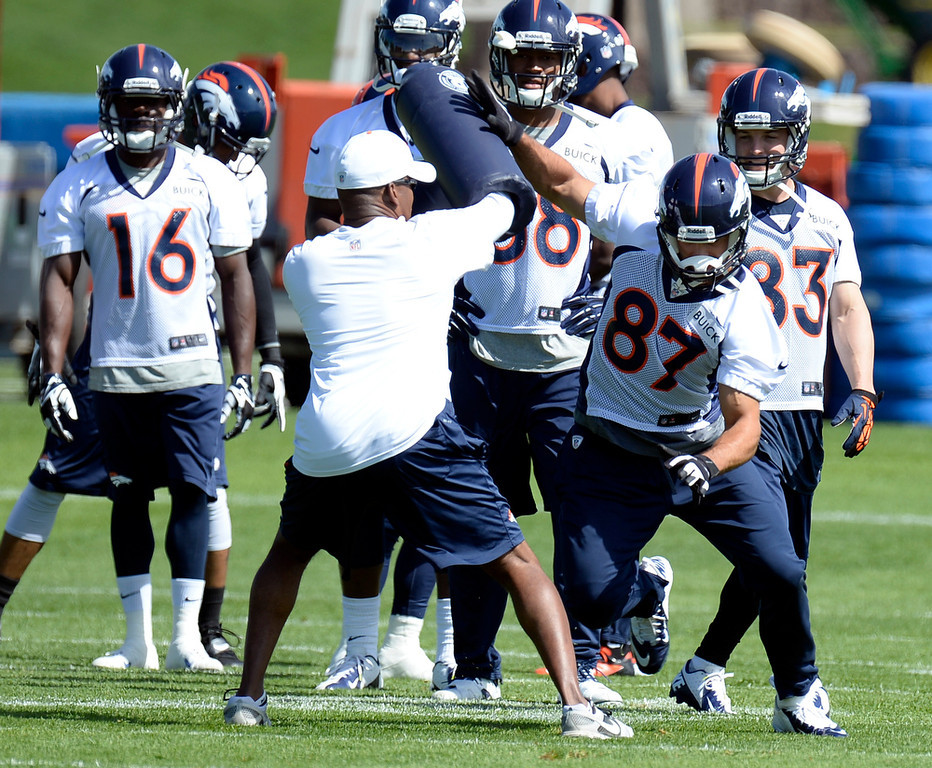. Eric Decker (87) of the Denver Broncos runs through drills during the teams OTAs May 20, 2013 at Dove Valley. All offseason training activities (OTAs) are voluntary until the mandatory minicamp June 11-13. (Photo By John Leyba/The Denver Post)