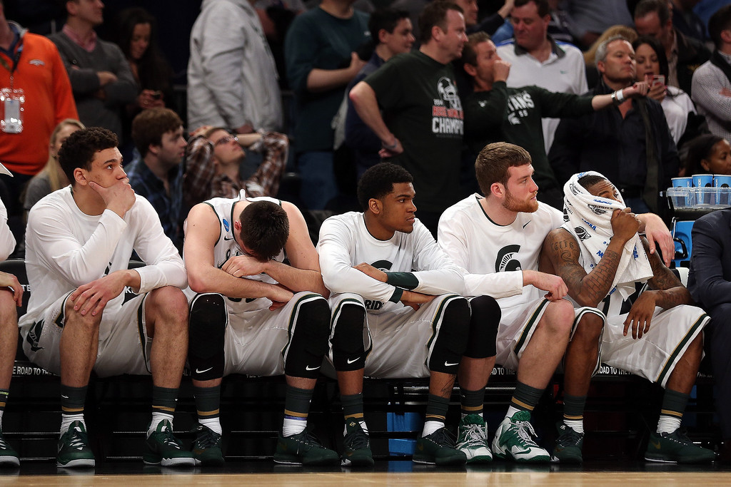 . The Michigan State Spartans bench looks on late in the game against the Connecticut Huskies during the East Regional Final of the 2014 NCAA Men\'s Basketball Tournament at Madison Square Garden on March 30, 2014 in New York City.  (Photo by Bruce Bennett/Getty Images)