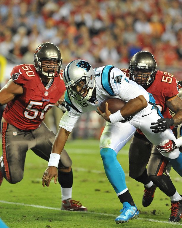 . TAMPA, FL - OCTOBER 24:  Quarterback Cam Newton #1 of the Carolina Panthers runs for a gain in the 1st quarter against the Tampa Bay Buccaneers October 24, 2013 at Raymond James Stadium in Tampa, Florida. (Photo by Al Messerschmidt/Getty Images)
