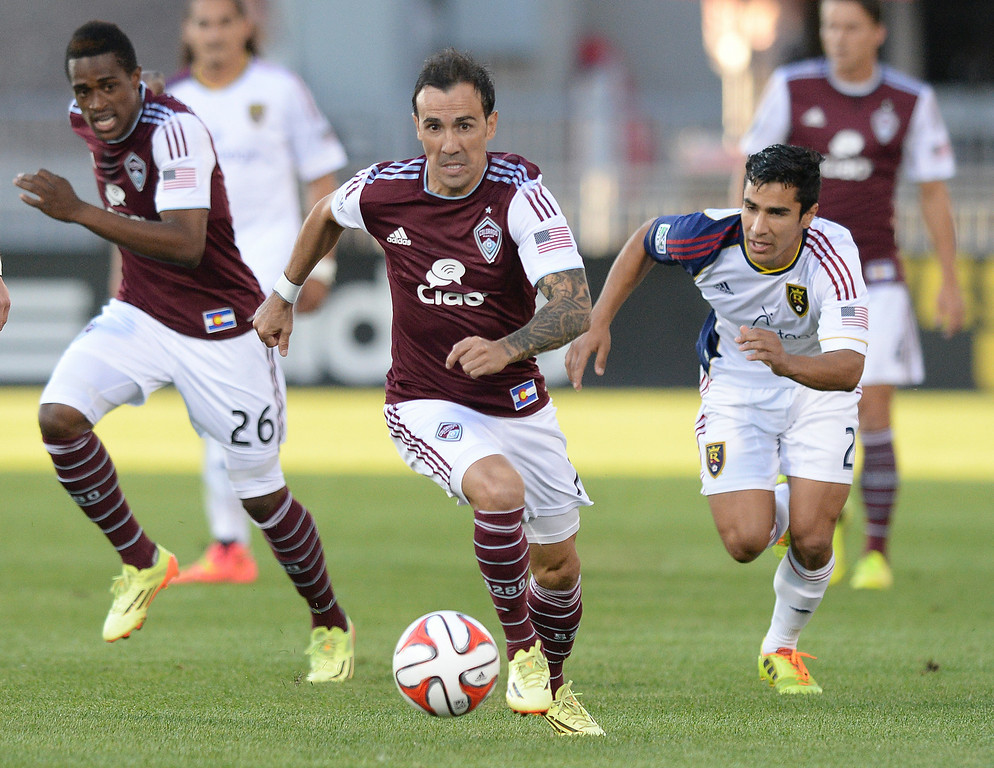 . COMMERCE CITY, CO - AUGUST 1: Colorado forward Vicente Sanchez, center, made a run with the ball in the first half. The Colorado Rapids hosted Real Salt Lake at Dick\'s Sporting Goods Park Saturday night, August 1, 2014.  Photo by Karl Gehring/The Denver Post