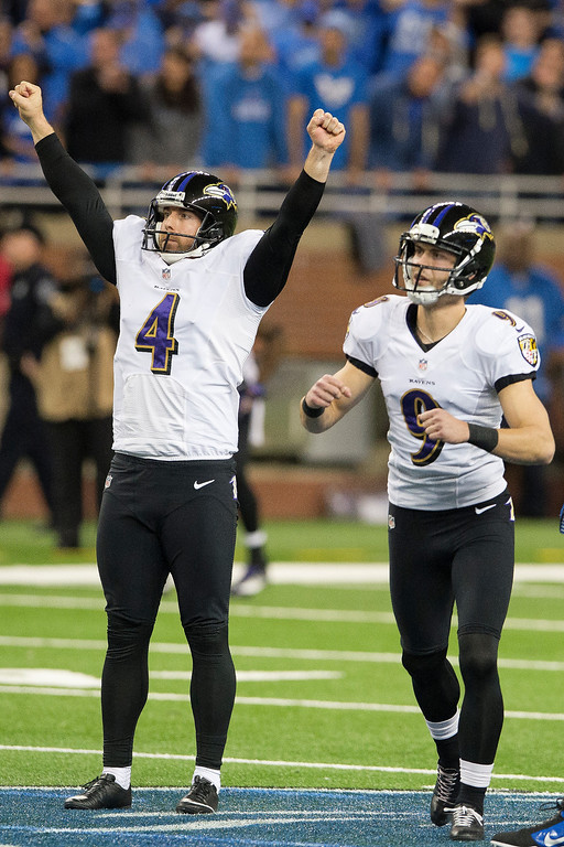 . Punter Sam Koch #4 celebrates with kicker Justin Tucker #9 of the Baltimore Ravens after Tucker hit a 61-yard game-winning field goals with less than a minute left during the second half against the Detroit Lions at Ford Field on December 16, 2013 in Detroit, Michigan. The Ravens defeated the Lions 18-16. (Photo by Jason Miller/Getty Images)