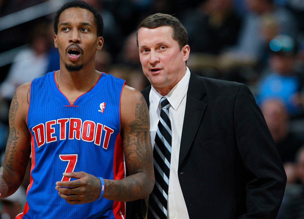 . Detroit Pistons guard Brandon Jennings, left, confers with head coach John Loyer during time out against the Denver Nuggets in the third quarter of the Nuggets\' 118-109 victory in an NBA basketball game in Denver on Wednesday, March 19, 2014. (AP Photo/David Zalubowski)