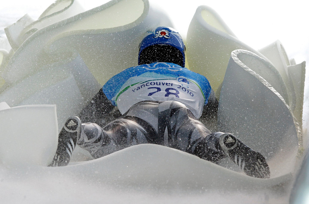 . Shinsuke Tamaya of Japan is stopped by a pile of foam at the finish area during a training run for the men\'s skeleton at the Vancouver 2010 Olympics in Whistler, British Columbia, Monday, Feb. 15, 2010. (AP Photo/Michael Sohn)