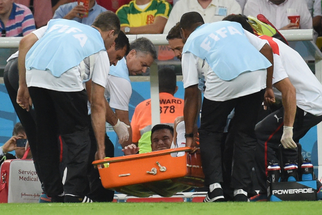 . Chile\'s midfielder Charles Aranguiz is carried off on a stretcher during a Group B football match between Spain and Chile in the Maracana Stadium in Rio de Janeiro during the 2014 FIFA World Cup on June 18, 2014.  CHRISTOPHE SIMON/AFP/Getty Images