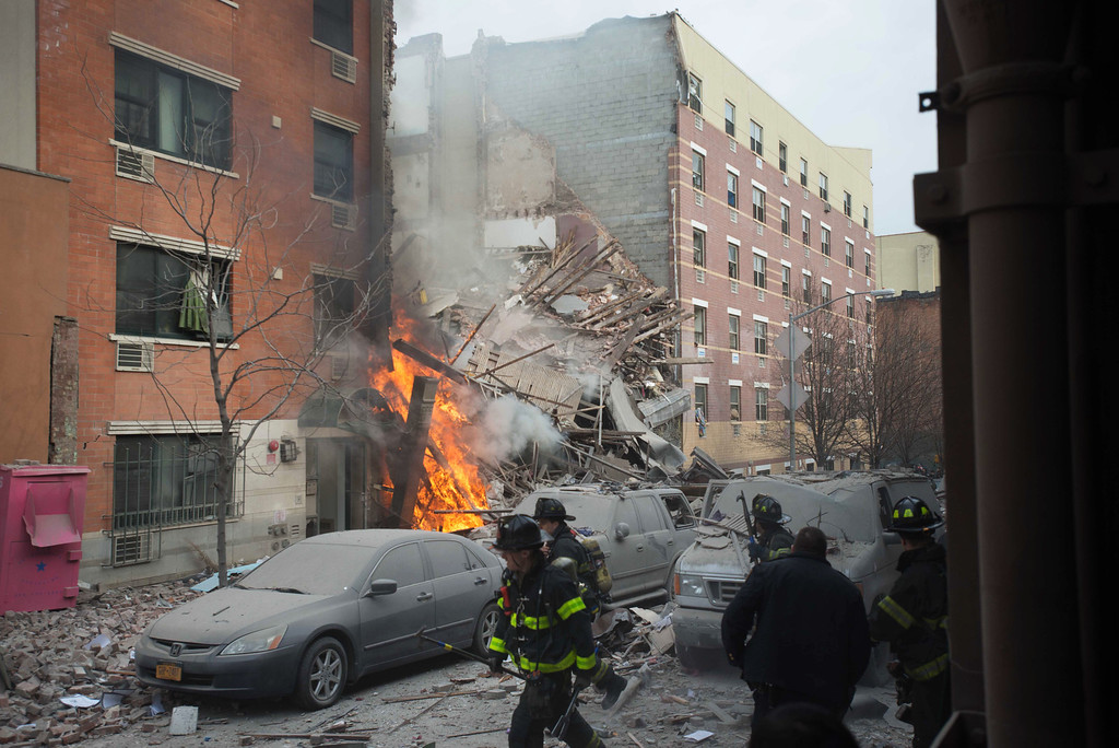 . Firefighters work the scene of an explosion that leveled two apartment buildings in the East Harlem neighborhood of New York, Wednesday, March 12, 2014. Con Edison spokesman Bob McGee says a resident from a building adjacent to the two that collapsed reported that he smelled gas inside his apartment, but thought the odor could be coming from outside. (AP Photo/Jeremy Sailing)