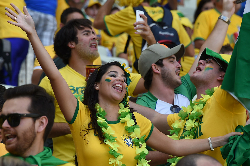 . Brazil\'s fans cheer before the quarter-final football match between Brazil and Colombia at the Castelao Stadium in Fortaleza during the 2014 FIFA World Cup on July 4, 2014. VANDERLEI ALMEIDA/AFP/Getty Images