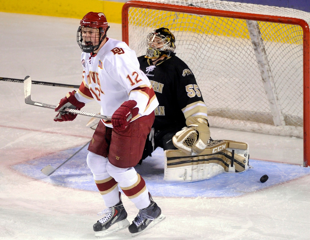. DENVER, CO. - NOVEMBER 16: Denver right wing Ty Loney (12) reacted after he screened Western Michigan goalie Lukas Hafner while David Makowski put the puck in the net in the second period. The University of Denver hockey team hosted Western Michigan at Magness Arena Saturday night, November 16, 2013.  Photo By Karl Gehring/The Denver Post