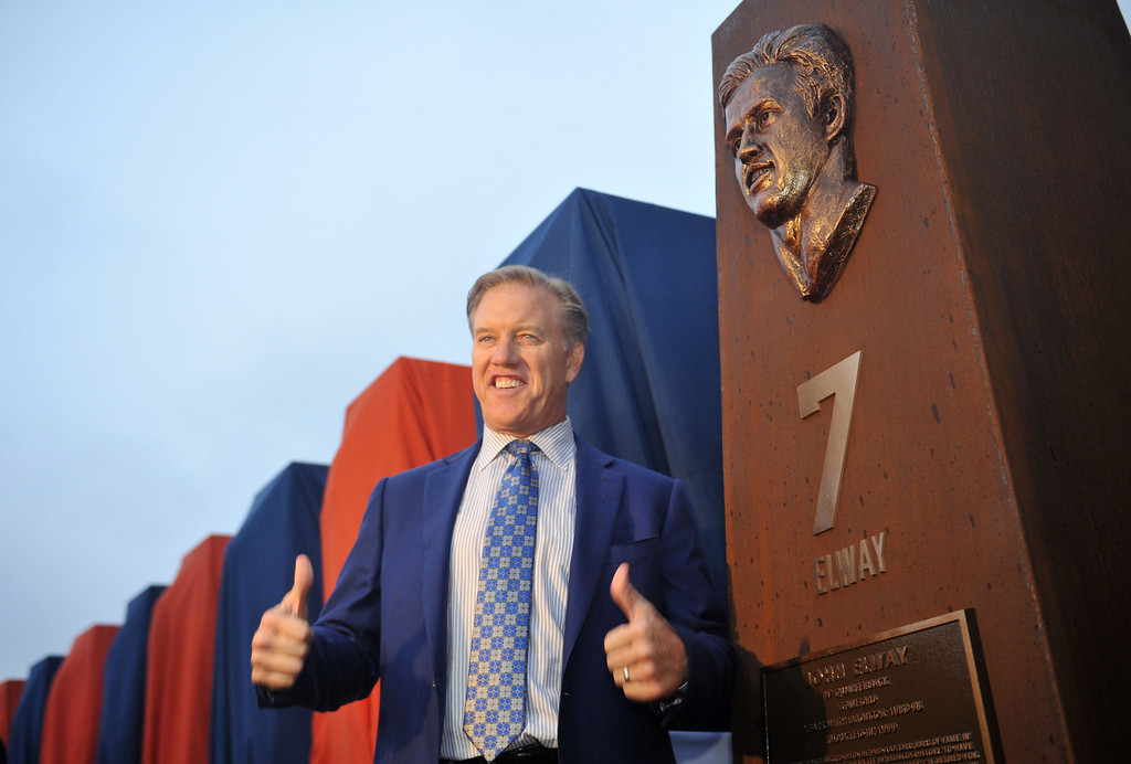 . DENVER, CO - September 27 : John Elway unveils his sculpture at the Denver Broncos Ring of Fame Plaza in Sports Authority Field at Mile High. Denver, Colorado. September 27, 2013. The Plaza features pillars honoring each of the 24 players in the Broncos� Ring of Fame. (Photo by Hyoung Chang/The Denver Post)