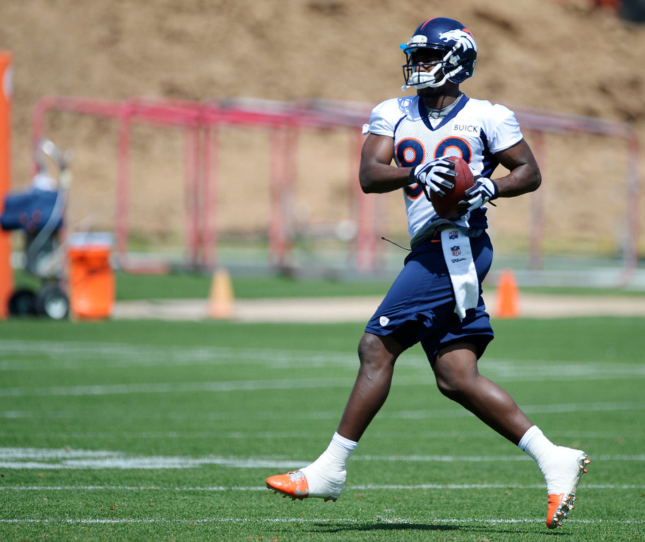 . Denver Broncos Gerell Robinson (89) catches a pass during OTAs June 11, 2014 at Dove Valley. (Photo by John Leyba/The Denver Post)