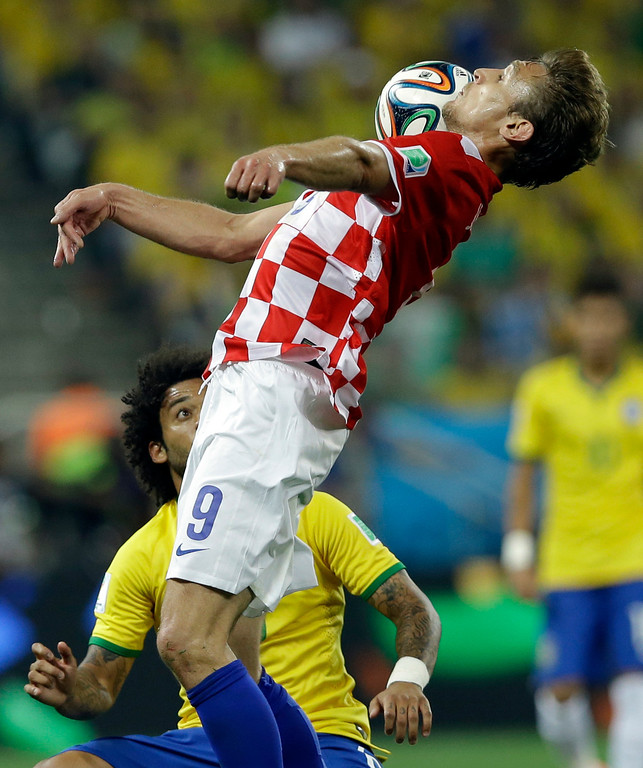 . Croatia\'s Nikica Jelavic controls the ball during the group A World Cup soccer match between Brazil and Croatia, the opening game of the tournament, in the Itaquerao Stadium in Sao Paulo, Brazil, Thursday, June 12, 2014. (AP Photo/Kirsty Wigglesworth)