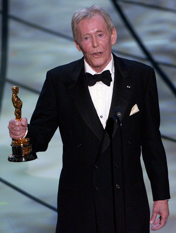 . Actor Peter O\'Toole accepts his honorary Oscar from the Academy of Motion Picture Arts and Sciences during the 75th annual Academy Awards telecast in Los Angeles on March 23, 2003. O\'Toole, the charismatic actor who achieved instant stardom as Lawrence of Arabia and was nominated eight times for an Academy Award, has died. He was 81. O\'Toole\'s agent Steve Kenis says the actor died Saturday, Dec. 14, 2013 at a hospital following a long illness. (AP Photo/Kevork Djansezian)