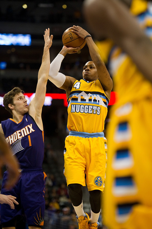 . DENVER, CO - DECEMBER 20: Randy Foye #4 of the Denver Nuggets shoots against Goran Dragic #1 of the Phoenix Suns during the first quarter of an NBA game at the Pepsi Center on December 20, 2013, in Denver, Colorado. (Photo by Daniel Petty/The Denver Post)