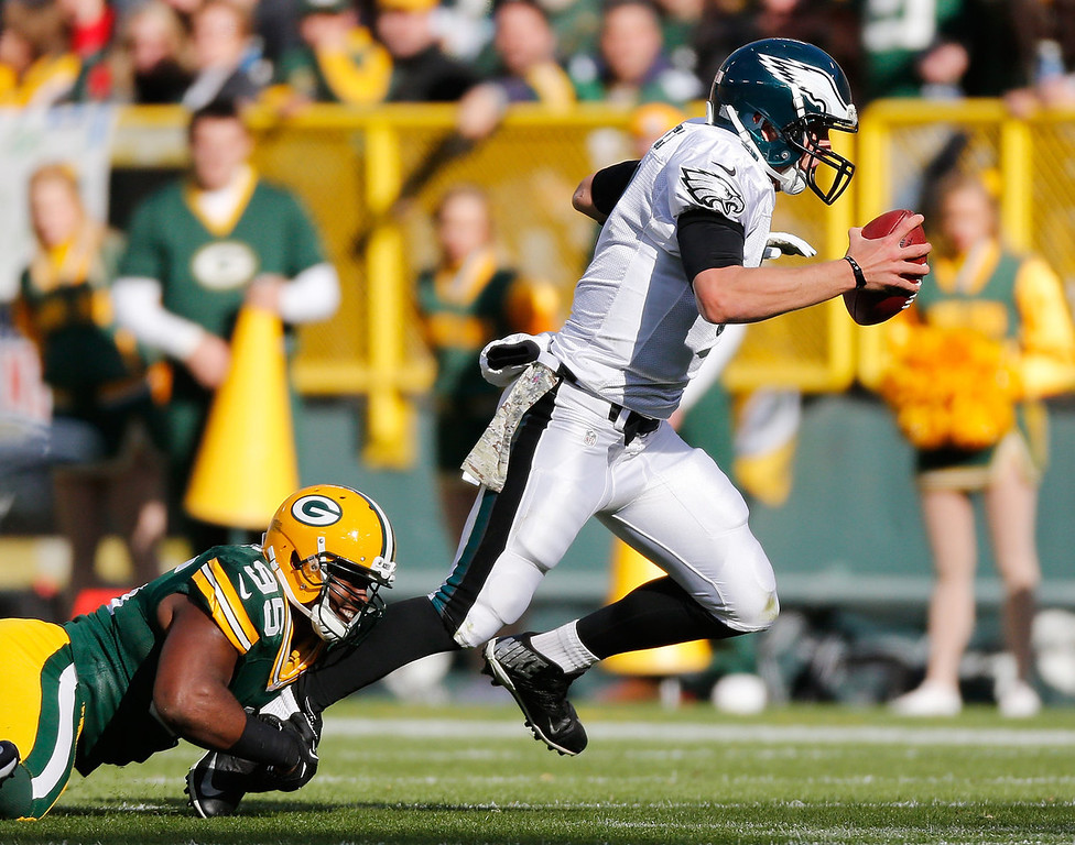 . Nick Foles #9 of the Philadelphia Eagles is tackled by Datone Jones #95 of the Green Bay Packers during a first quarter run at Lambeau Field on November 10, 2013 in Green Bay, Wisconsin. (Photo by Gregory ShamusGetty Images)