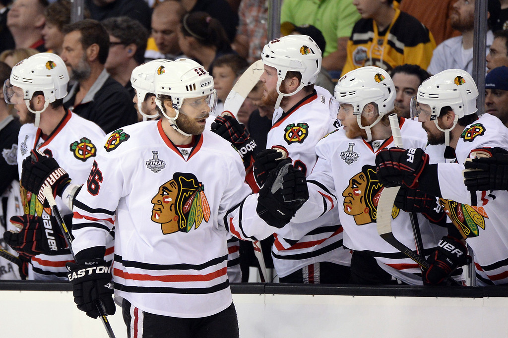 . Michal Handzus #26 of the Chicago Blackhawks celebrates with teammates after scoring a goal in the first period against the Boston Bruins in Game Four of the 2013 NHL Stanley Cup Final at TD Garden on June 19, 2013 in Boston, Massachusetts.  (Photo by Harry How/Getty Images)