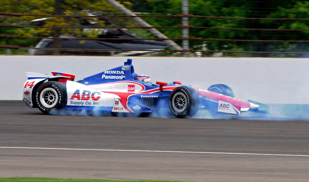 . Takuma Sato, of Japan, spins in the second turn during the Indianapolis 500 auto race at the Indianapolis Motor Speedway in Indianapolis, Sunday, May 26, 2013. Sato made no contact and returned to the race. (AP Photo/John Maxwell)