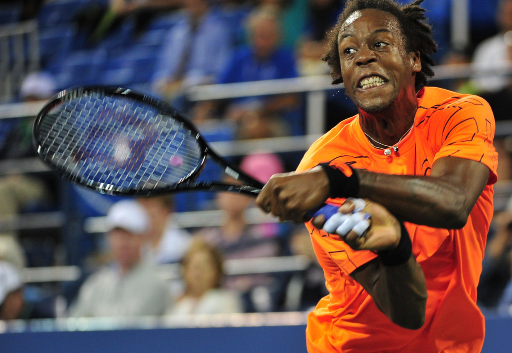 . Gael Monfils of France returns a shot to John Isner of the US during their 2013 US Open men\'s singles match at the USTA Billie Jean King National Tennis Center August 29, 2013 in New York. STAN HONDA/AFP/Getty Images