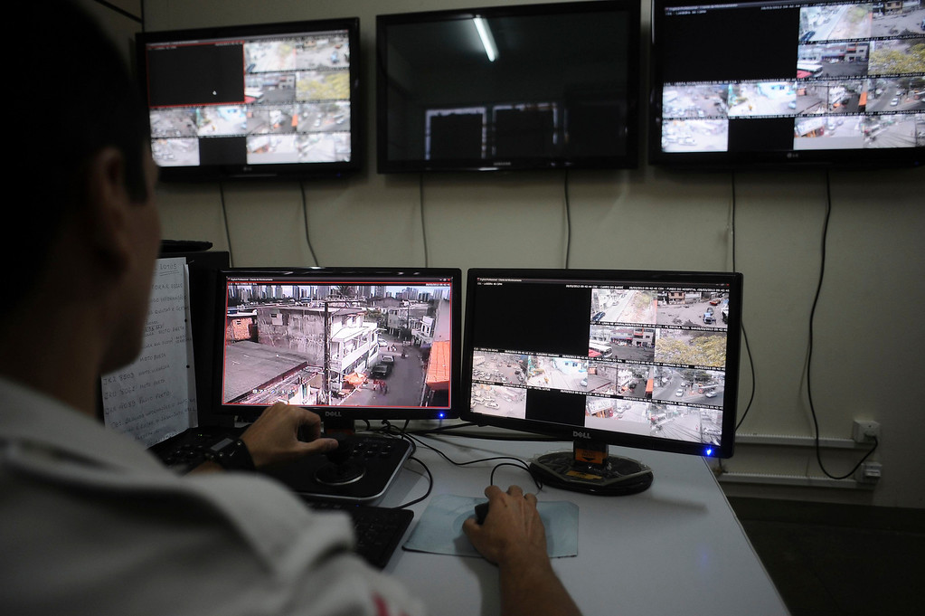 . A police officer watches live security cameras aimed at different points of the city where violence is common, at a command center in Salvador, Bahia State, March  28, 2013. One of Brazil\'s main tourist destinations and a 2014 World Cup host city, Salvador suffers from an unprecedented wave of violence with an increase of over 250% in the murder rate, according to the Brazilian Center for Latin American Studies (CEBELA). Picture taken March 28, 2013.  REUTERS/Lunae Parracho