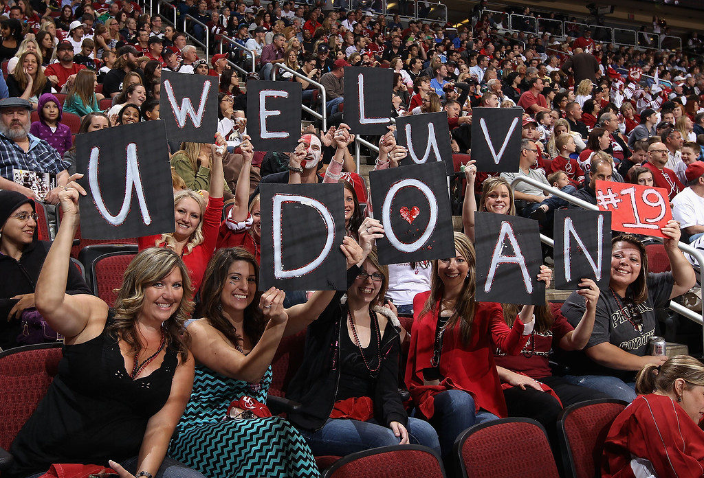 ". GLENDALE, AZ - APRIL 26:  Fans of the Phoenix Coyotes hold up signs that read "" We Luv U Doan #19\"" during the NHL game against the Colorado Avalanche at Jobing.com Arena on April 26, 2013 in Glendale, Arizona. The Avalanche defeated the Coyotes 5-4 in an overtime shoot-out.   (Photo by Christian Petersen/Getty Images)"