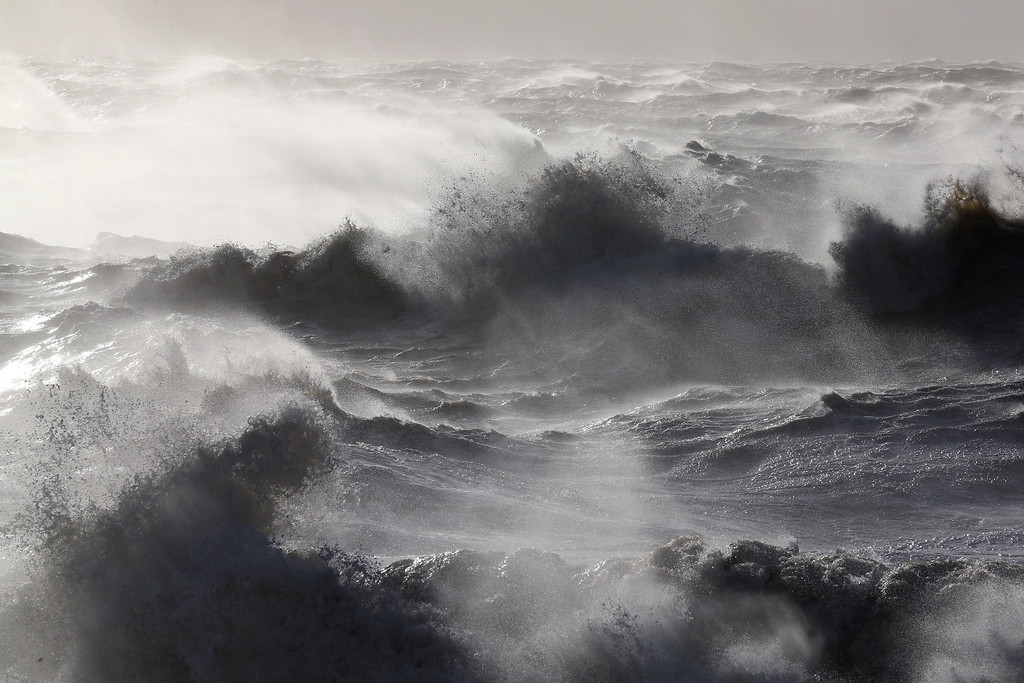 . Large waves, produced by storm force winds, break on the shore on October 28, 2013 in Dover, England.  Approximately 220,000 homes are without power and two deaths have been recorded after much of southern England has been affected by a severe storm. Transport links on road, rail, air and sea have been severely disrupted by hurricane-force winds  that have almost reached 100 mph in places.  (Photo by Oli Scarff/Getty Images)