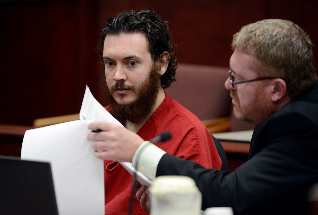. Defense Attorney Daniel King, right, and  Aurora theater shooting suspect James Holmes review advisement documents in court in Centennial, Colo., on Tuesday, June 4, 2013. Holmes was allowed to change his plea to not guilty by reason of insanity. (AP Photo/The Denver Post, Andy Cross, Pool)