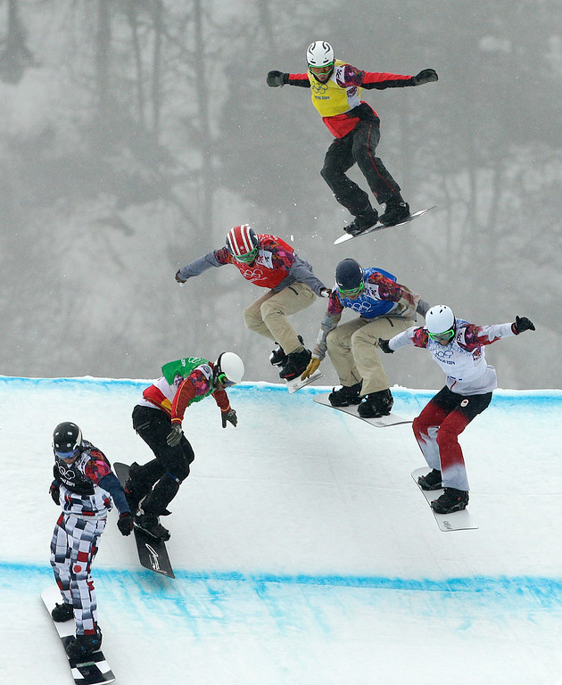 . Russia\'s Nikolay Olyunin, from left, Spain\'s Lucas Eguibar, United States\' Trevor Jacob, Norway\'s Stian Sivertzen, United States\' Alex Deibold, and Canada\'s Kevin Hill compete during the men\'s snowboard cross semifinal at the Rosa Khutor Extreme Park, at the 2014 Winter Olympics, Tuesday, Feb. 18, 2014, in Krasnaya Polyana, Russia. (AP Photo/Jae C. Hong)
