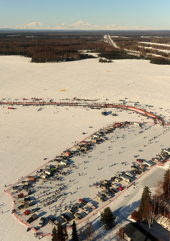 . With Mount Foraker, Mount Hunter and Mount McKinley on the horizon, mushers prepare their teams for the start of the Iditarod Trail Sled Dog Race, Sunday, March 2, 2014, in Willow, Alaska. (AP Photo/Anchorage Daily News, Bob Hallinen)