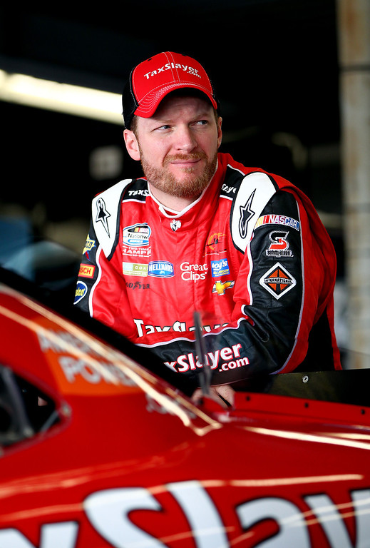 . Dale Earnhardt Jr., driver of the #88 TaxSlayer.com Chevrolet, stands in the garage during practice for the NASCAR Nationwide Series DRIVE4COPD 300 at Daytona International Speedway on February 21, 2013 in Daytona Beach, Florida.  (Photo by Jonathan Ferrey/Getty Images)