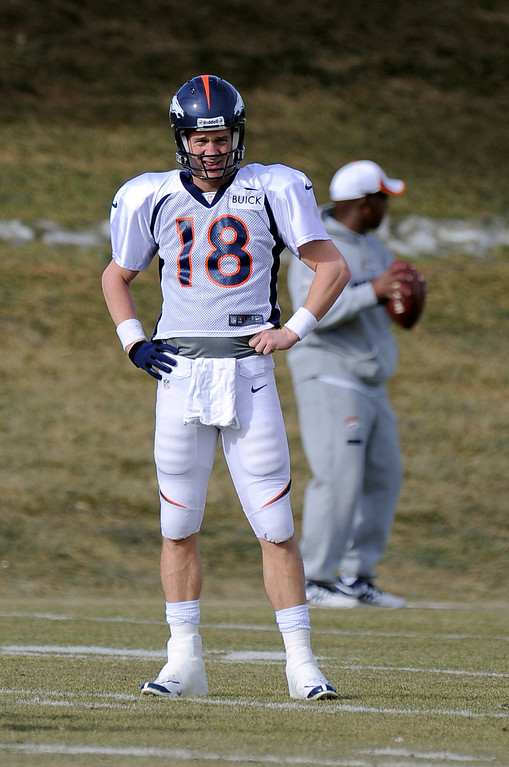 . Denver Broncos quarterback Peyton Manning (18) looks on during drills at practice December 18, 2013 at Dove Valley (Photo by John Leyba/The Denver Post)