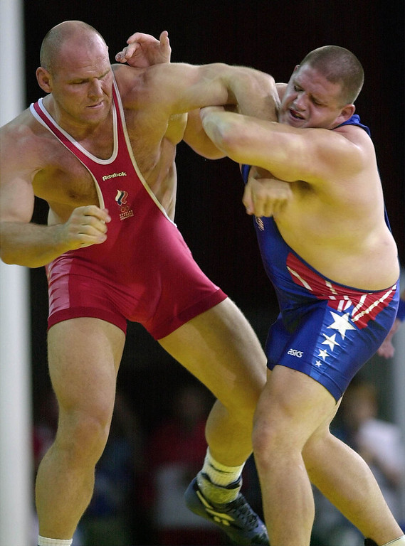 . In this Sept. 27, 2000 file photo, Rulon Gardner, right, of the United States, holds the arm of Alexander Karelin of Russia during the final bout in the 130 kg class of Greco-Roman wrestling event at the Summer Olympic Games in Sydney. Gardner\'s epic upset of Russian wrestling great Alexander Karelin in 2000 remains one of the most compelling moments of the modern Olympics. Starting in 2020, youngsters looking to Gardner and Karelin for inspiration won\'t have a chance to excel on the sport\'s biggest stage. Gardner and nearly everyone else associated with the sport in the U.S. were jolted Tuesday, Feb. 12, 2013 when International Olympic Committee leaders dropped wrestling from the Summer Games. (AP Photo/Katsumi Kasahara, File )