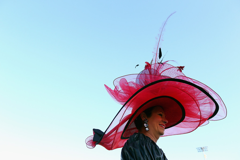 . A race fan watches the morning training for the Kentucky Derby at Churchill Downs on May 2, 2014 in Louisville, Kentucky.  (Photo by Andy Lyons/Getty Images)