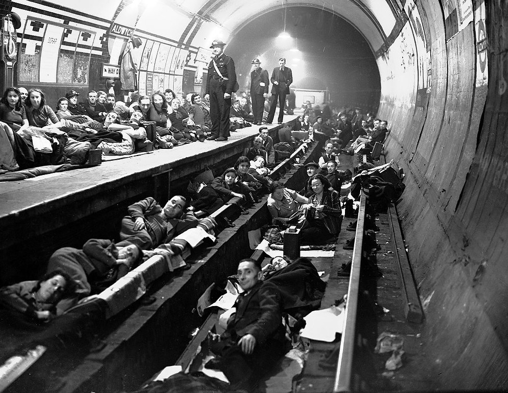 . Londoners sleep on the platform and on the train tracks at Aldwych Underground station, London, during heavy  all-night Nazi bombing raids, Oct. 8, 1940. (AP Photo)