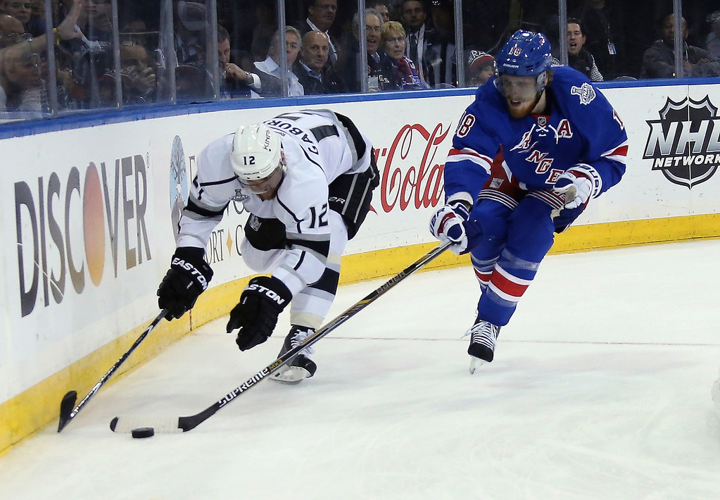 . Marc Staal #18 of the New York Rangers pokes the puck away from Marian Gaborik #12 of the Los Angeles Kings during the first period of Game Four of the 2014 NHL Stanley Cup Final at Madison Square Garden on June 11, 2014 in New York, New York.  (Photo by Bruce Bennett/Getty Images)