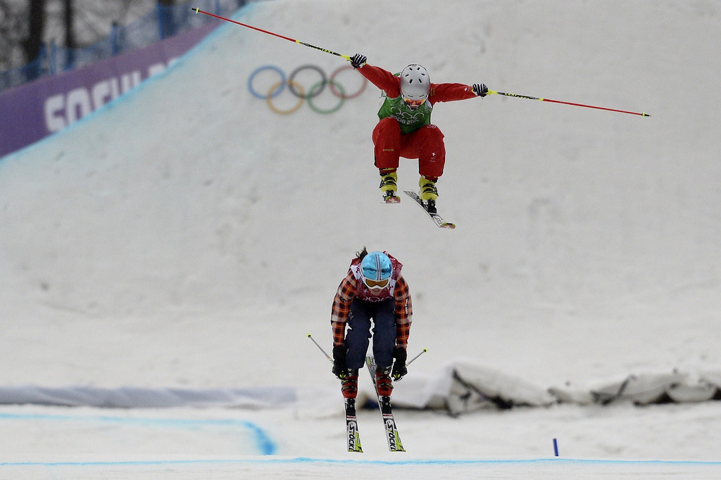 . Switzerland\'s Fanny Smith (top) and Canada\'s Kelsey Serwa compete in the Women\'s Freestyle Skiing Ski Cross 1/8 Finals at the Rosa Khutor Extreme Park during the Sochi Winter Olympics on February 21, 2014.  FRANCK FIFE/AFP/Getty Images
