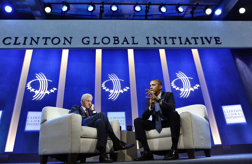 . US President Barack Obama (R) speaks as he participates with former President Bill Clinton in a conversation about the future of health care reform in America, and the benefits of expanding access to quality health care around the globe at Clinton Global Initiative in New York on September 24, 2013. JEWEL SAMAD/AFP/Getty Images