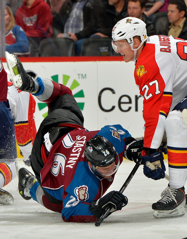 . Colorado Avalanche center Paul Stastny (26) trips against Florida Panthers center Nick Bjugstad (27) during the first period of an NHL hockey game, Saturday, Nov. 16, 2013, in Denver. (AP Photo/Jack Dempsey)