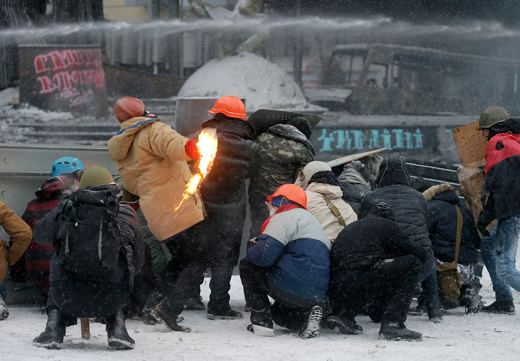 . Protesters  clash with police in central Kiev, Ukraine, Wednesday, Jan. 22, 2014. (AP Photo/Efrem Lukatsky)