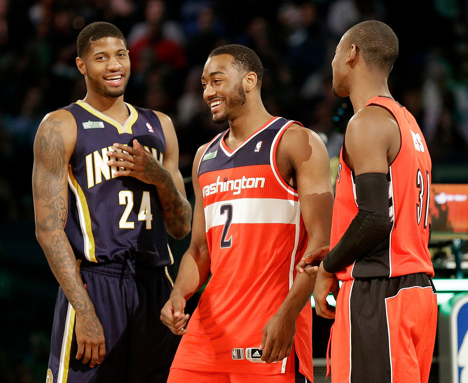 . The winners of the slam dunk contest Paul George of the Indiana Pacers, John Wall of the Washington Capitals and Terrence Ross celebrate during the skills competition at the NBA All Star basketball game, Saturday, Feb. 15, 2014, in New Orleans. (AP Photo/Gerald Herbert)
