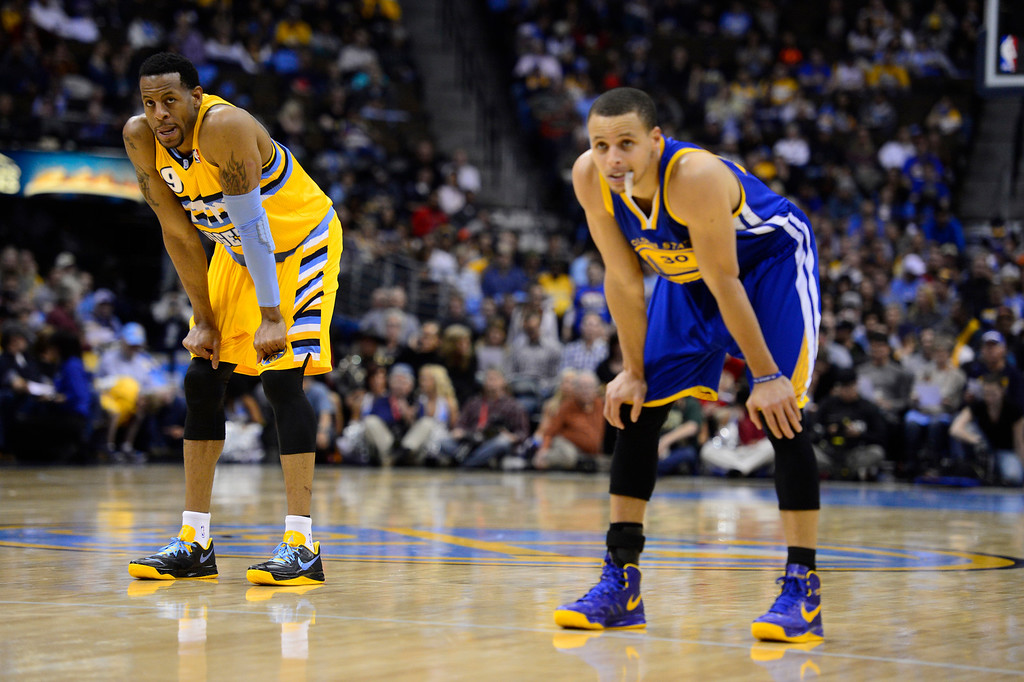 . DENVER, CO. - APRIL 23: Denver Nuggets shooting guard Andre Iguodala (9) and Golden State Warriors point guard Stephen Curry (30) take a breather during a break in the action in the third quarter. The Denver Nuggets took on the Golden State Warriors in Game 2 of the Western Conference First Round Series at the Pepsi Center in Denver, Colo. on April 23, 2013. (Photo by AAron Ontiveroz/The Denver Post)