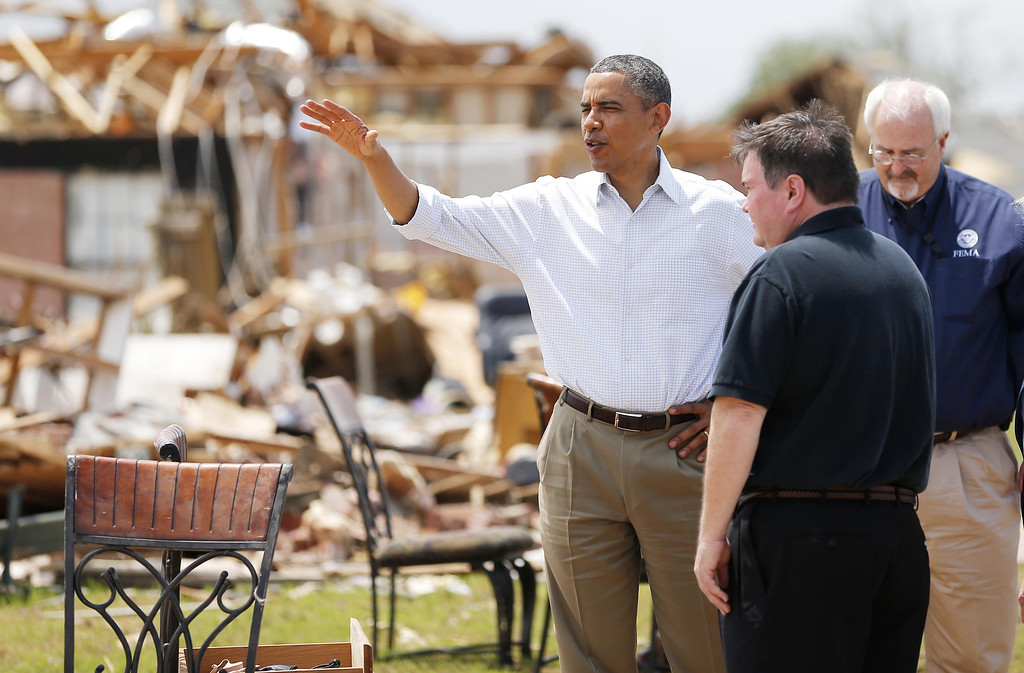 . President Barack Obama tours the Plaza Towers addition in Moore, Okla., beside Moore Mayor Glenn Lewis on Sunday, May 26, 2013. (AP Photo/The Oklahoman, Bryan Terry, Pool)