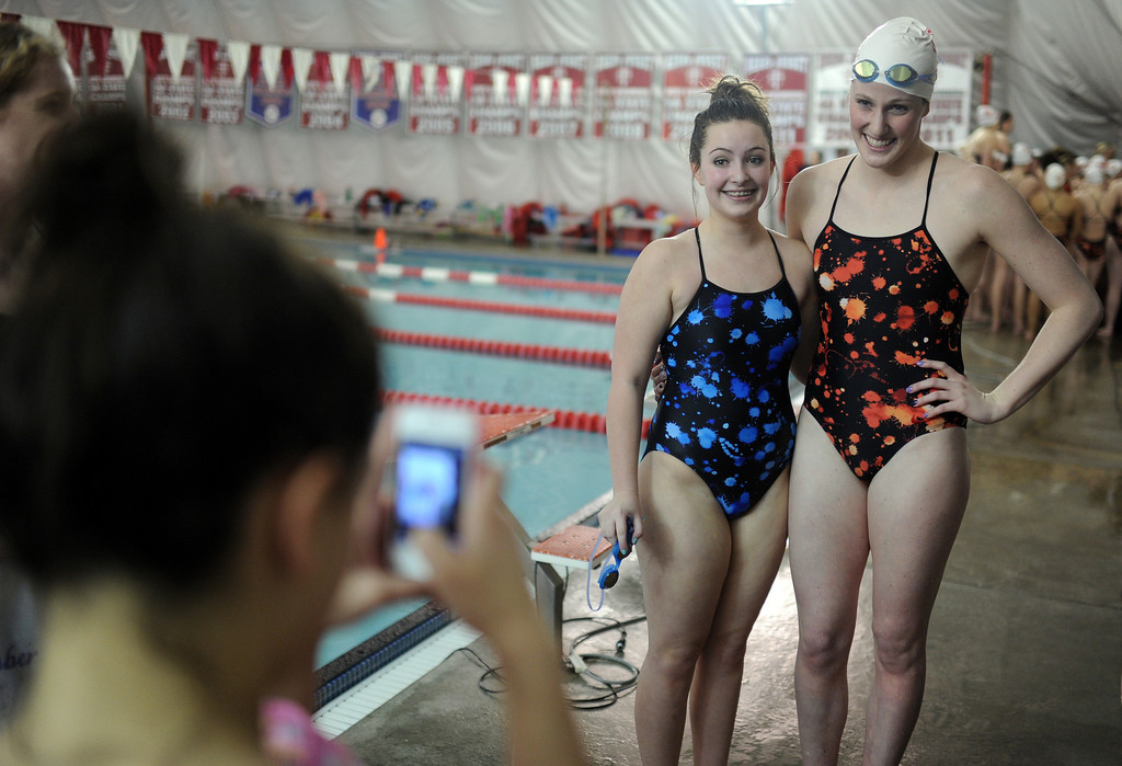 . Highlands Ranch swimmer Caroline Woodruff, left, takes picture with Olympic gold medalist Missy Franklin of Regis Jesuit after the swimming meet at Regis Jesuit swimming pool on Tuesday. Aurora. CO, January 8, 2013.  Hyoung Chang, The Denver Post