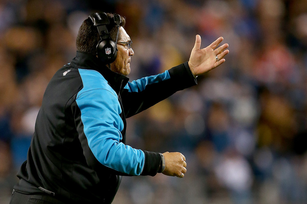 . Head coach Ron Rivera of the Carolina Panthers on the sideline in the first half while taking on the New England Patriots at Bank of America Stadium on November 18, 2013 in Charlotte, North Carolina.  (Photo by Streeter Lecka/Getty Images)