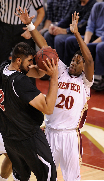 . DENVER, CO. - MARCH 2: Pioneers forward Royce O\'Neale (20) defended Aggies center Sim Bhullar (2) under the basket in the second half. The University of Denver men\'s basketball team defeated New Mexico State 66-60 Saturday evening, March 2, 2013 at Magness Arena. (Photo By Karl Gehring/The Denver Post)