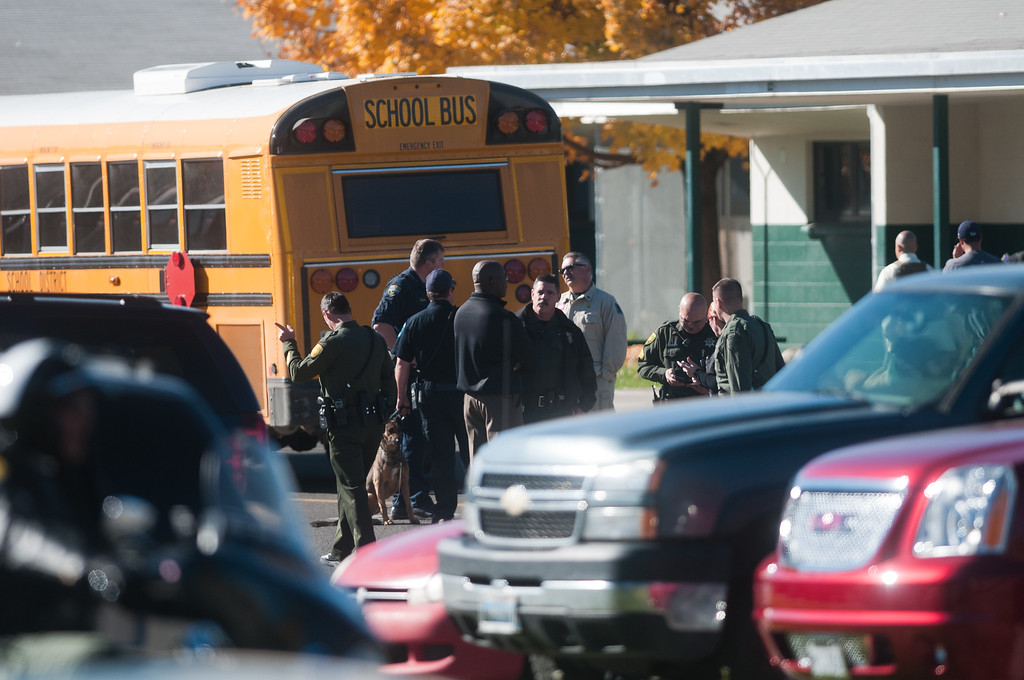 . Law enforcement gather in the parking lot after a shooting at Sparks Middle School October 21, 2013 in Sparks, Nevada. A staff member was killed and two students were injured after a student opened fire at the Nevada middle school. The suspected gunman was also killed. (Photo by David Calvert/Getty Images)