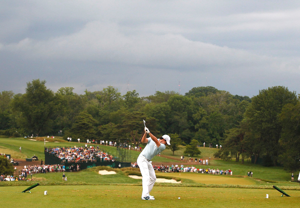 . Northern Ireland\'s Rory McIlroy tees off on the ninth hole during the first round of the 2013 U.S. Open golf championship at the Merion Golf Club in Ardmore, Pennsylvania, June 13, 2013. REUTERS/Matt Sullivan